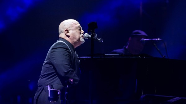 Billy Joel performing at Kauffman Stadium in Kansas City, Missouri on Friday, September 21, 2018.