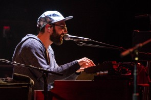 Amos Lee's band member performing at Uptown Theater in Kansas City, Missouri, on March 26, 2019.