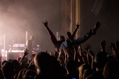 A fan crowdsurfing during I Prevail's performance