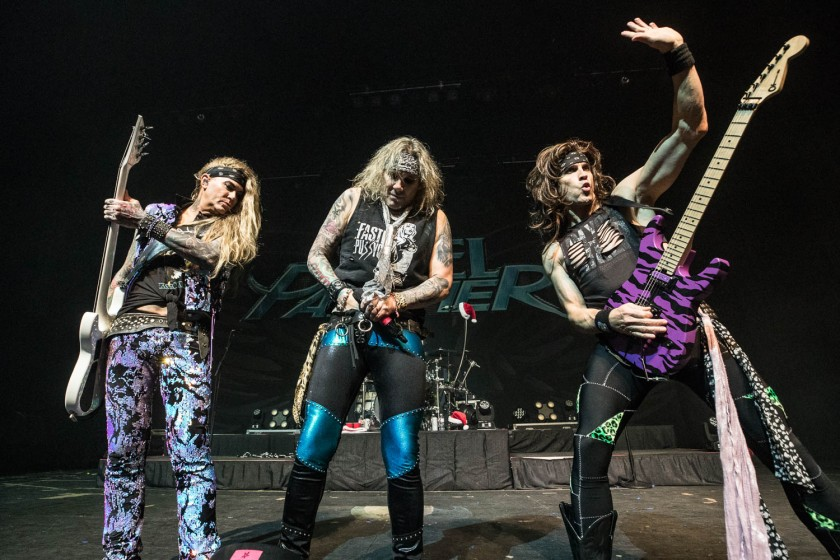 Steel Panther performing at the Arvest Bank Theatre at The Midland in Kansas City, Missouri on December 15, 2019.