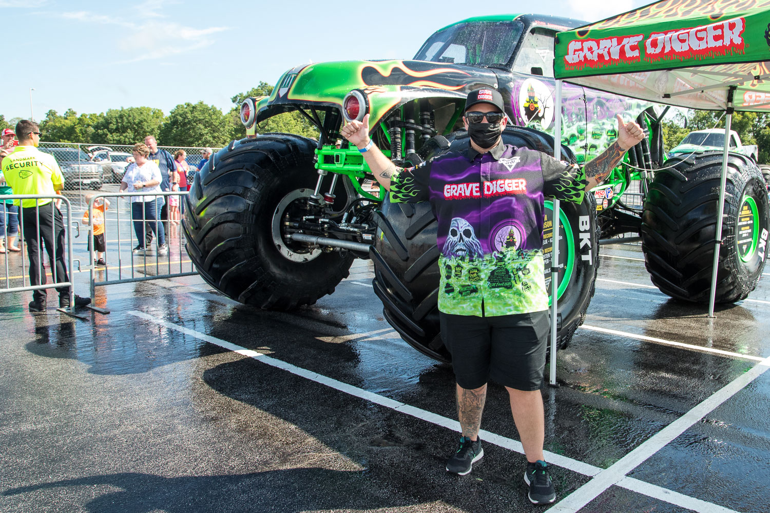 Adam Anderson poses for a photo in front of Gravedigger during the Monster Jam Pit Party prior to the main event at GEHA Field at Arrowhead on Saturday evening, June 26, 2021.