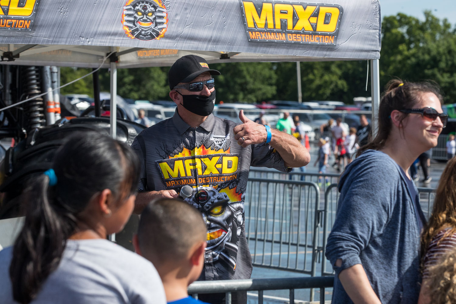 Tom Meents, driver of the Maximum Destruction (Max-D) truck, poses for a photo with fans during the Monster Jam Pit Party prior to the main event at GEHA Field at Arrowhead on Saturday evening, June 26, 2021.
