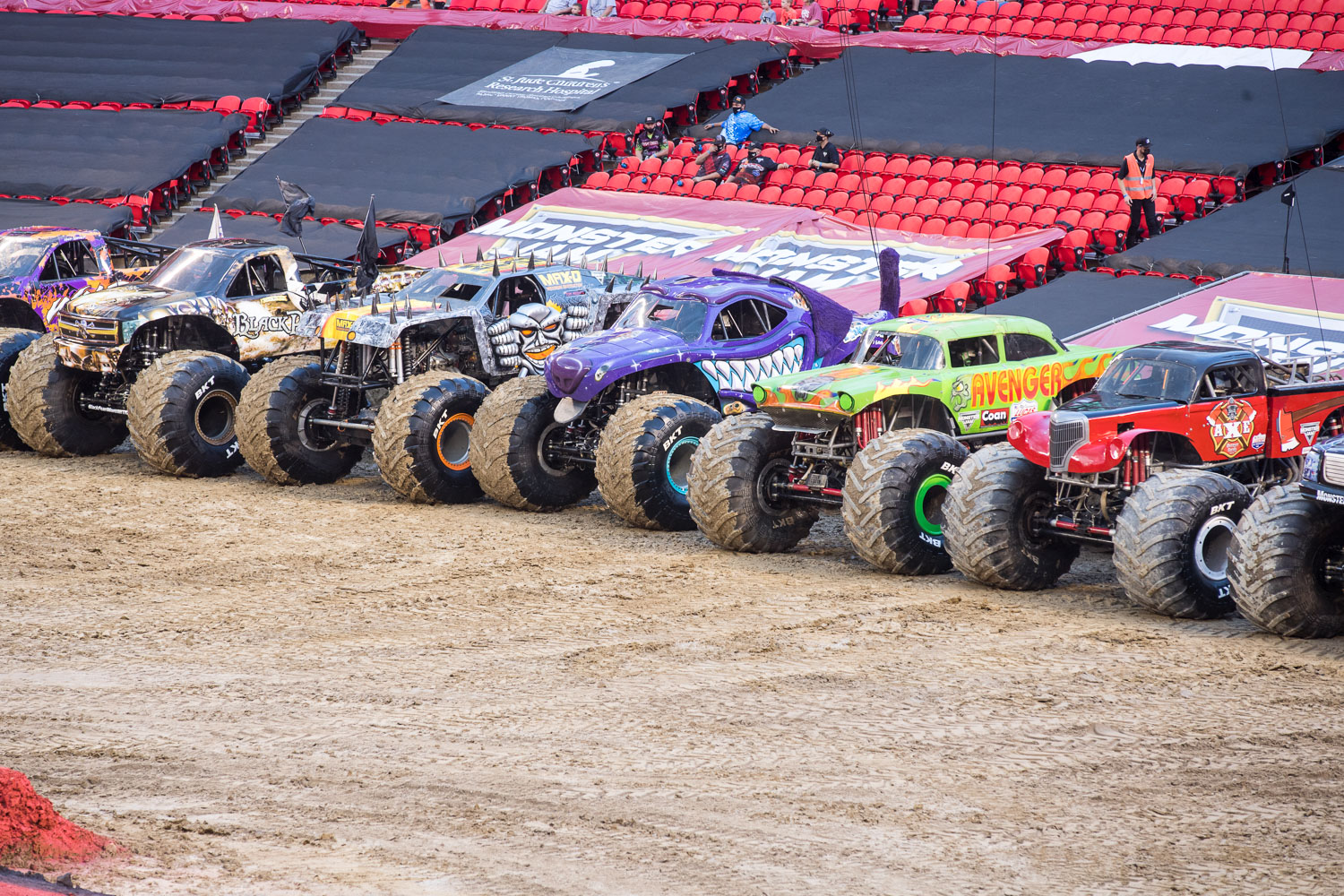 Monster Trucks are lined up during Monster Jam at GEHA Field at Arrowhead on Saturday evening, June 26, 2021.