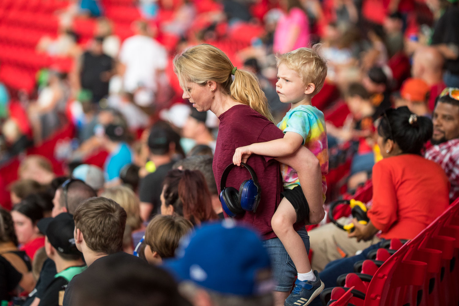 A mother and son make their way to their seats during Monster Jam at GEHA Field at Arrowhead on Saturday evening, June 26, 2021.