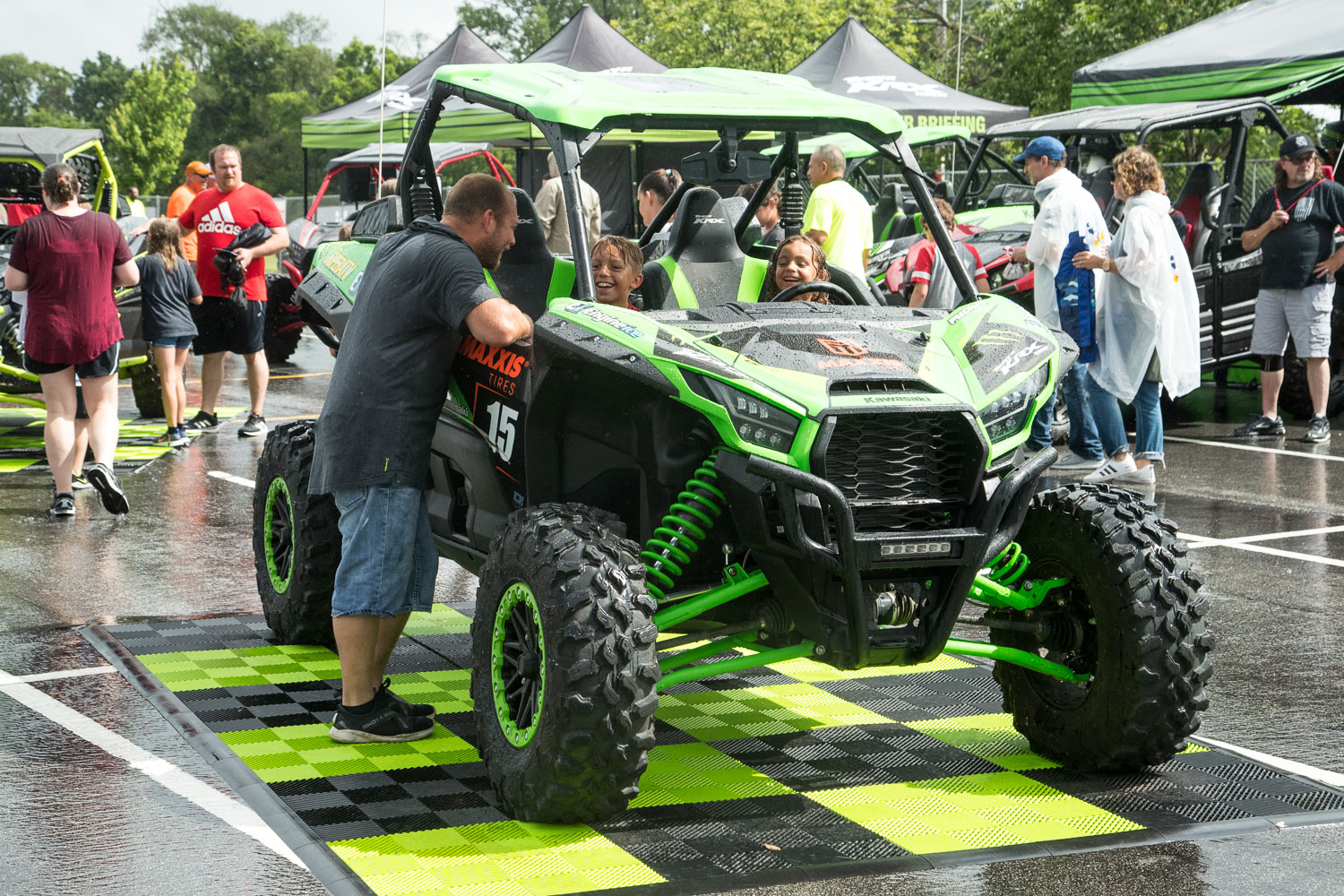 A family tries out a Kawasaki dune buggy during the Monster Jam Pit Party prior to the main event at GEHA Field at Arrowhead on Saturday evening, June 26, 2021.