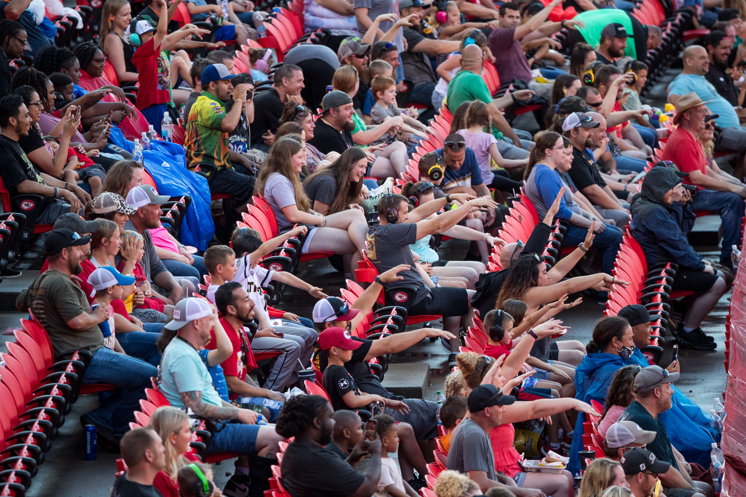 Fans throw up the zombie arms during Monster Jam at GEHA Field at Arrowhead on Saturday evening, June 26, 2021.