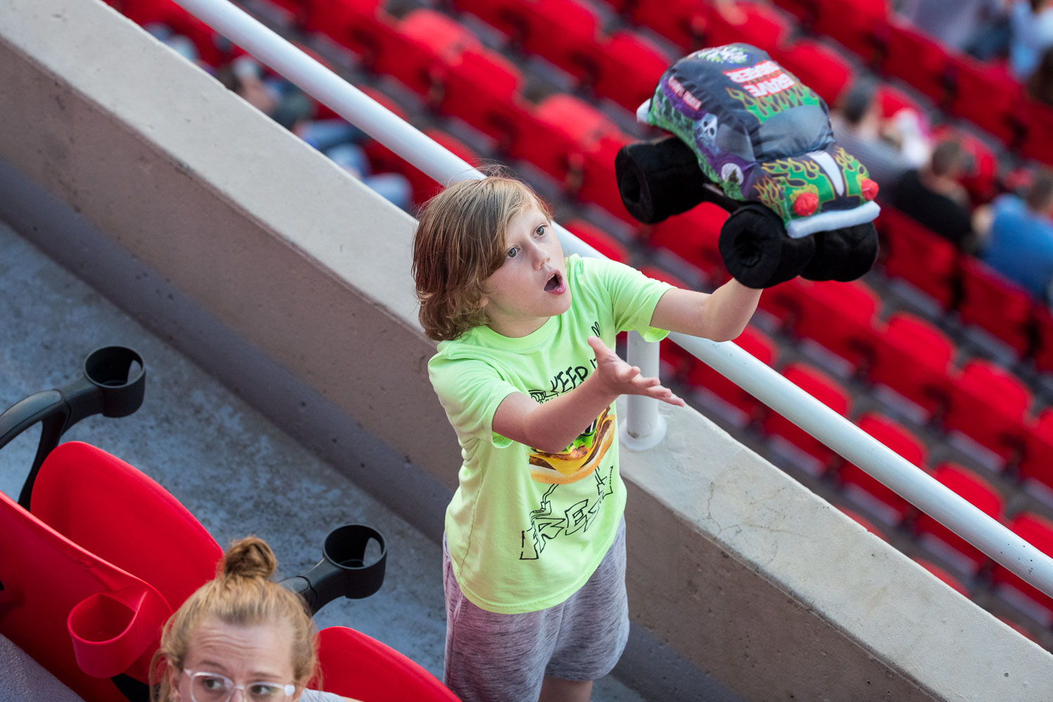 A young fan tosses a stuffed Gravedigger plush in the air during Monster Jam at GEHA Field at Arrowhead on Saturday evening, June 26, 2021.