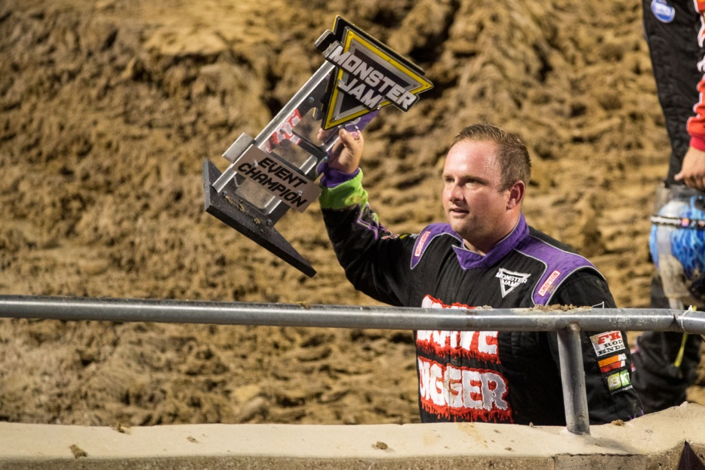 Adam Anderson, driver of Gravedigger holds up the Event Champion Trophy during Monster Jam at GEHA Field at Arrowhead on Saturday evening, June 26, 2021.