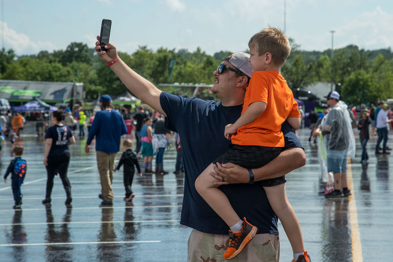 A father and son take a selfie together during the Monster Jam Pit Party prior to the main event at GEHA Field at Arrowhead on Saturday evening, June 26, 2021.