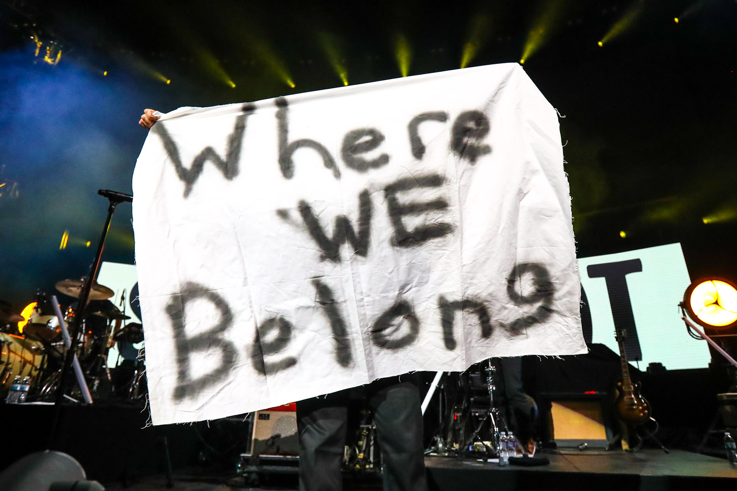 Jon Foreman of Switchfoot holding up a Where We Belong sign