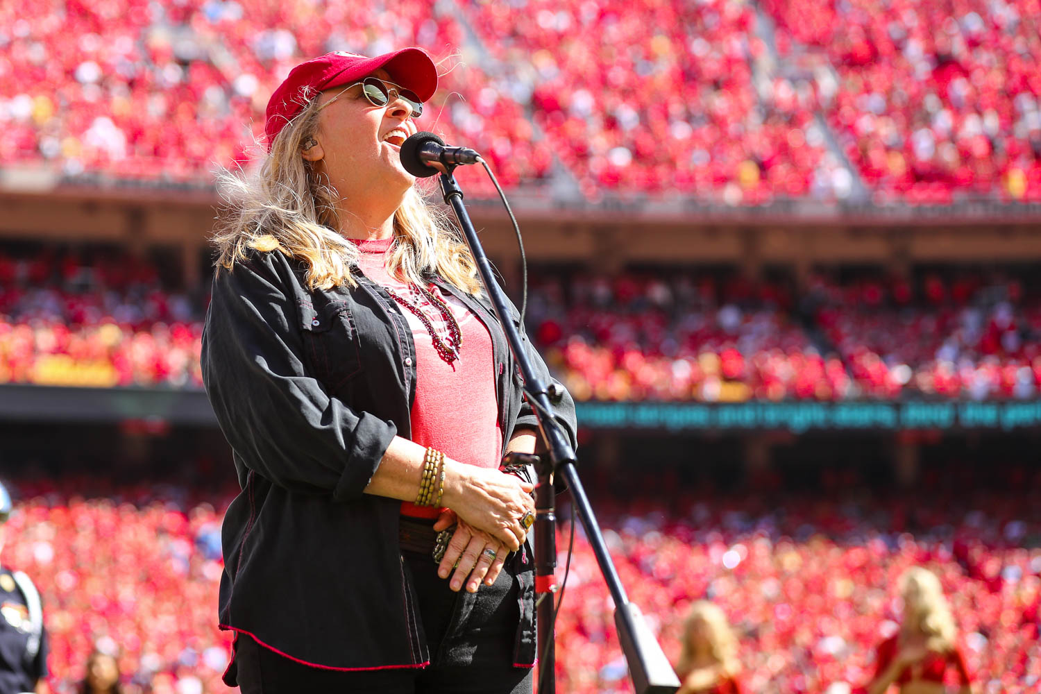 Melissa Etheridge singing the National Anthem prior to an NFL football game against the Los Angeles Chargers, Sunday, September 26, 2021 in Kansas City.